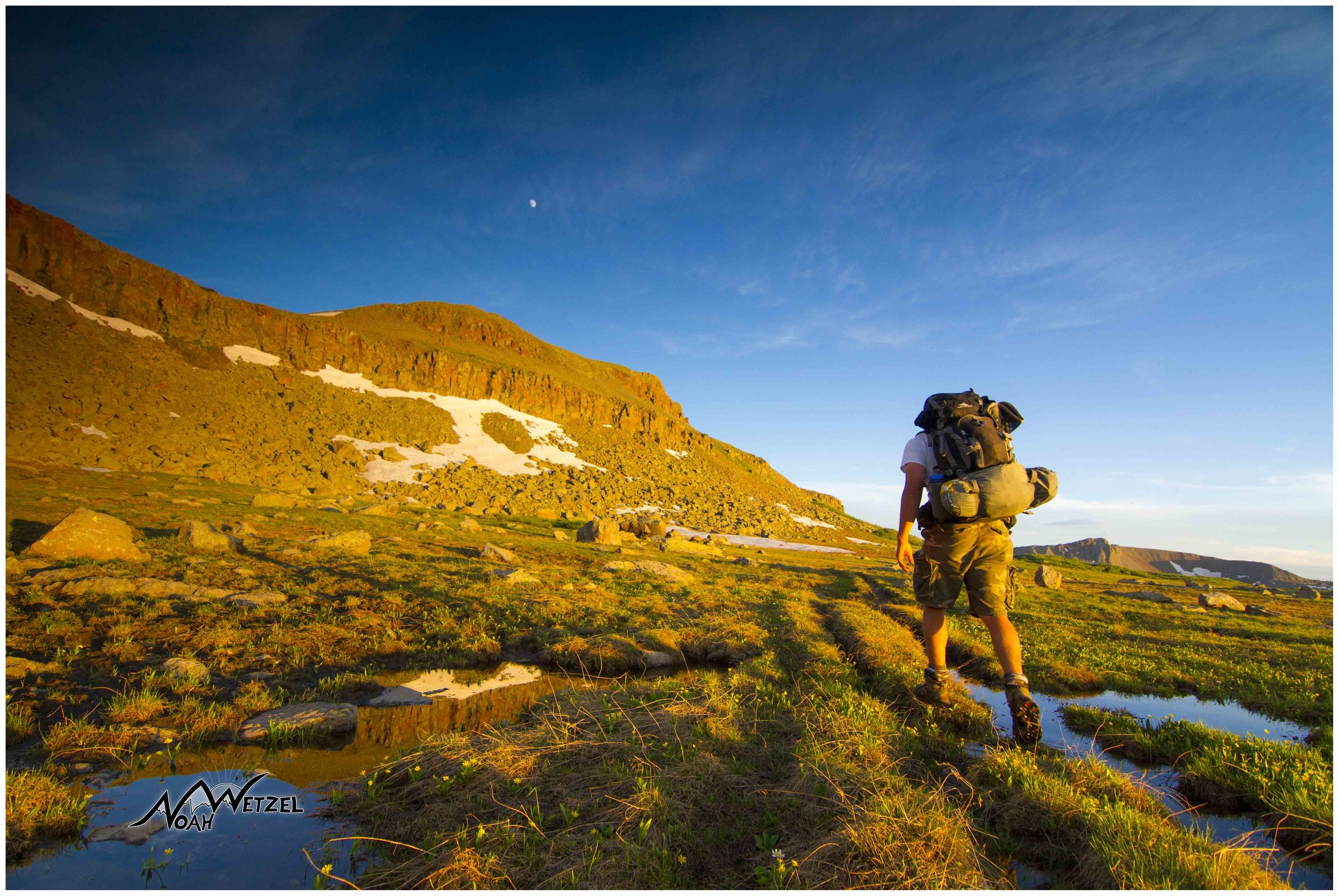 My brother Ben Wetzel making good time approaching sunset while backpacking in the Flat Tops Wilderness, Colorado.
