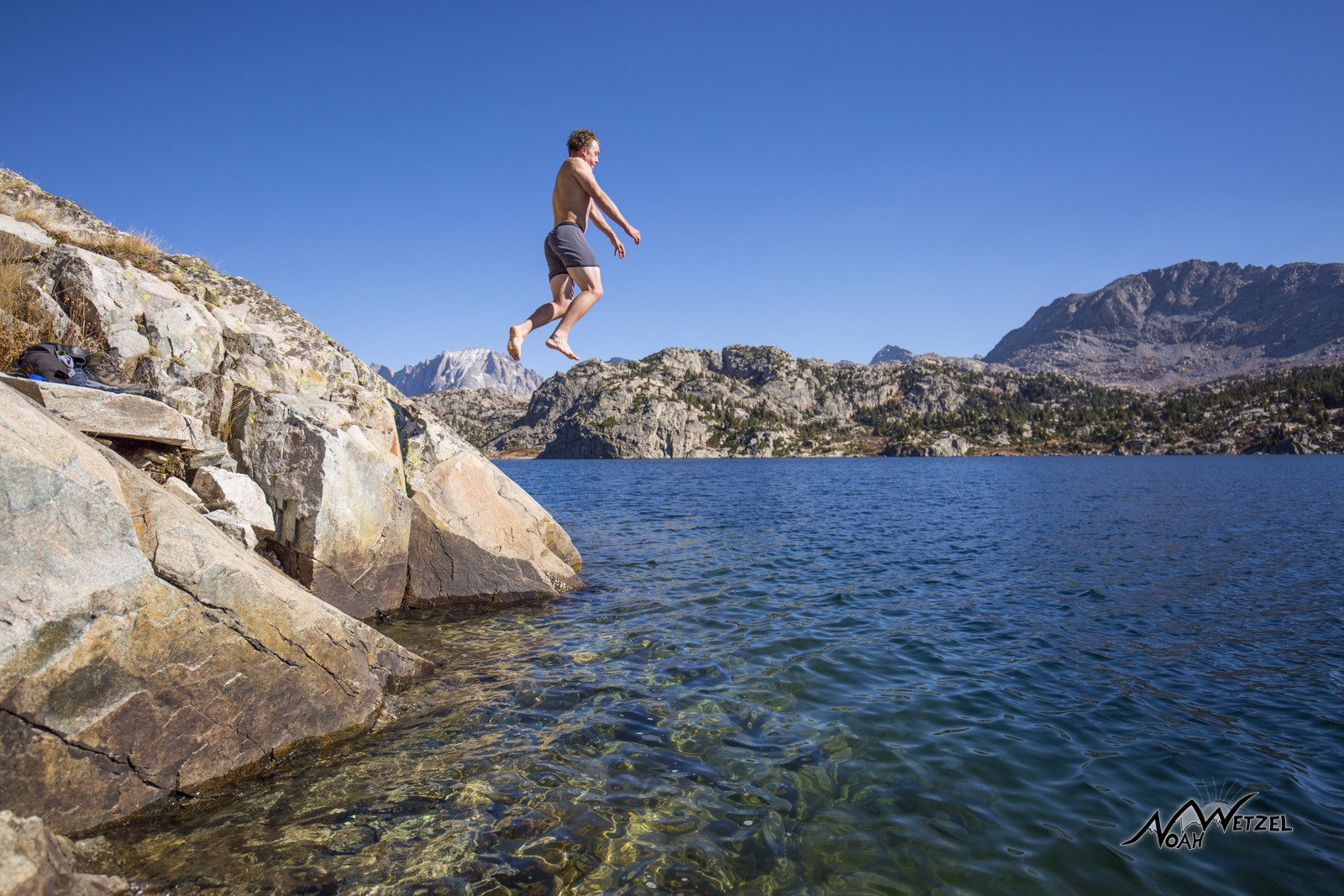 Ben Wetzel jumping into Seneca Lake in late September in the Wind River Range. Wyoming.
