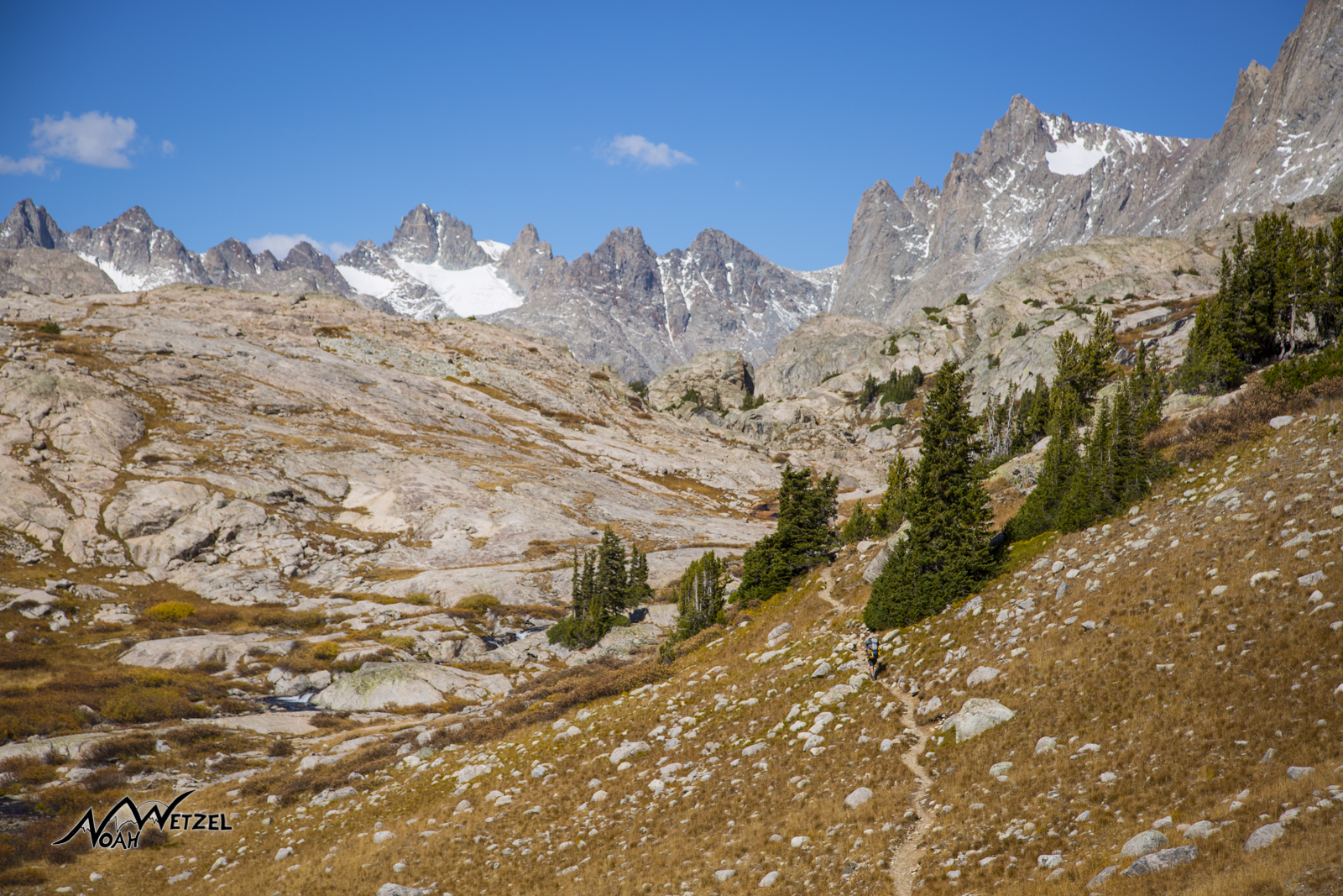 Ben hikes up the Indian Basin Trail with Titcomb Basin looming in the distance. Wind River Range. Wyoming