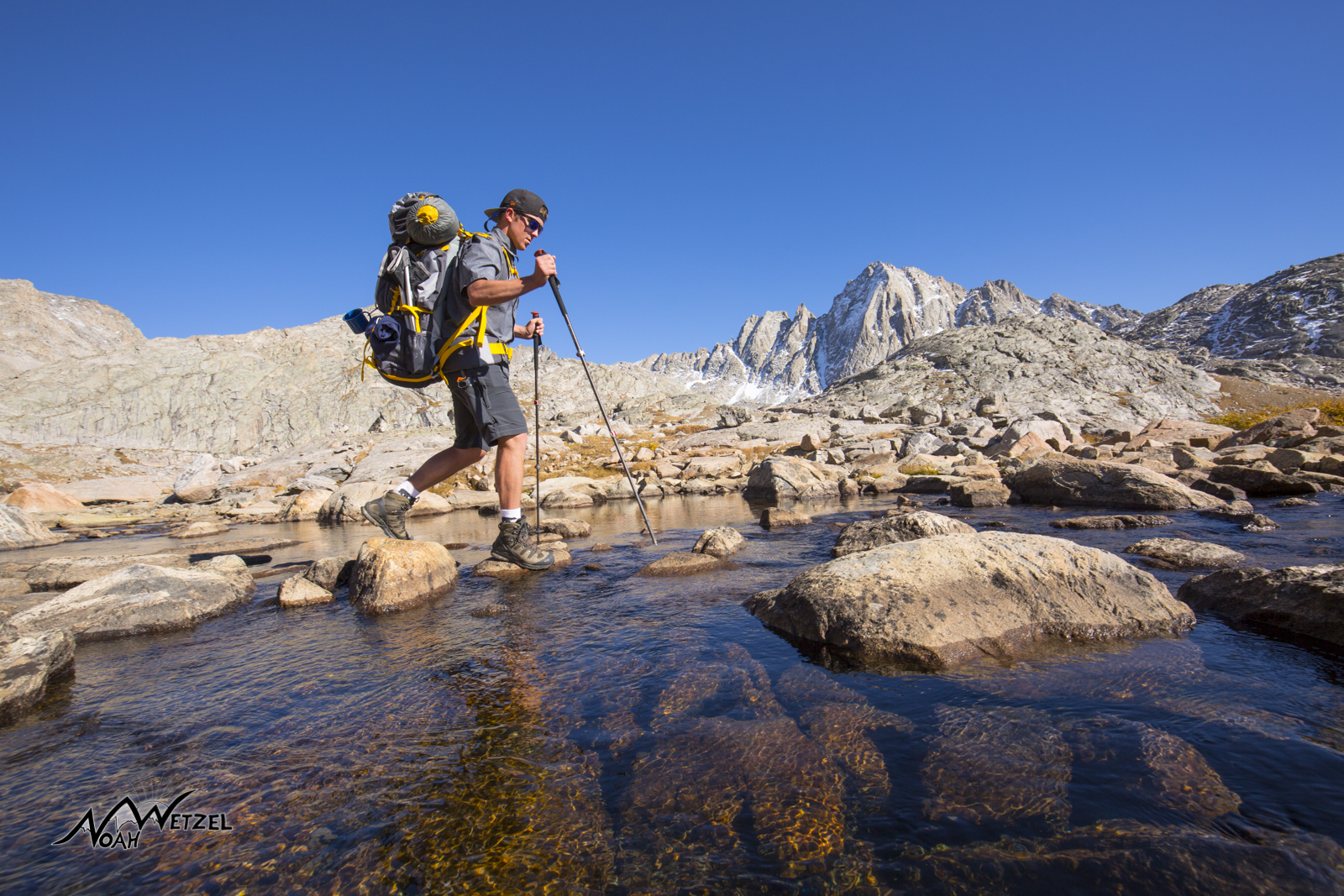 Ben Wetzel crossing a small stream at Indian Basin in the Wind River Range. Wyoming