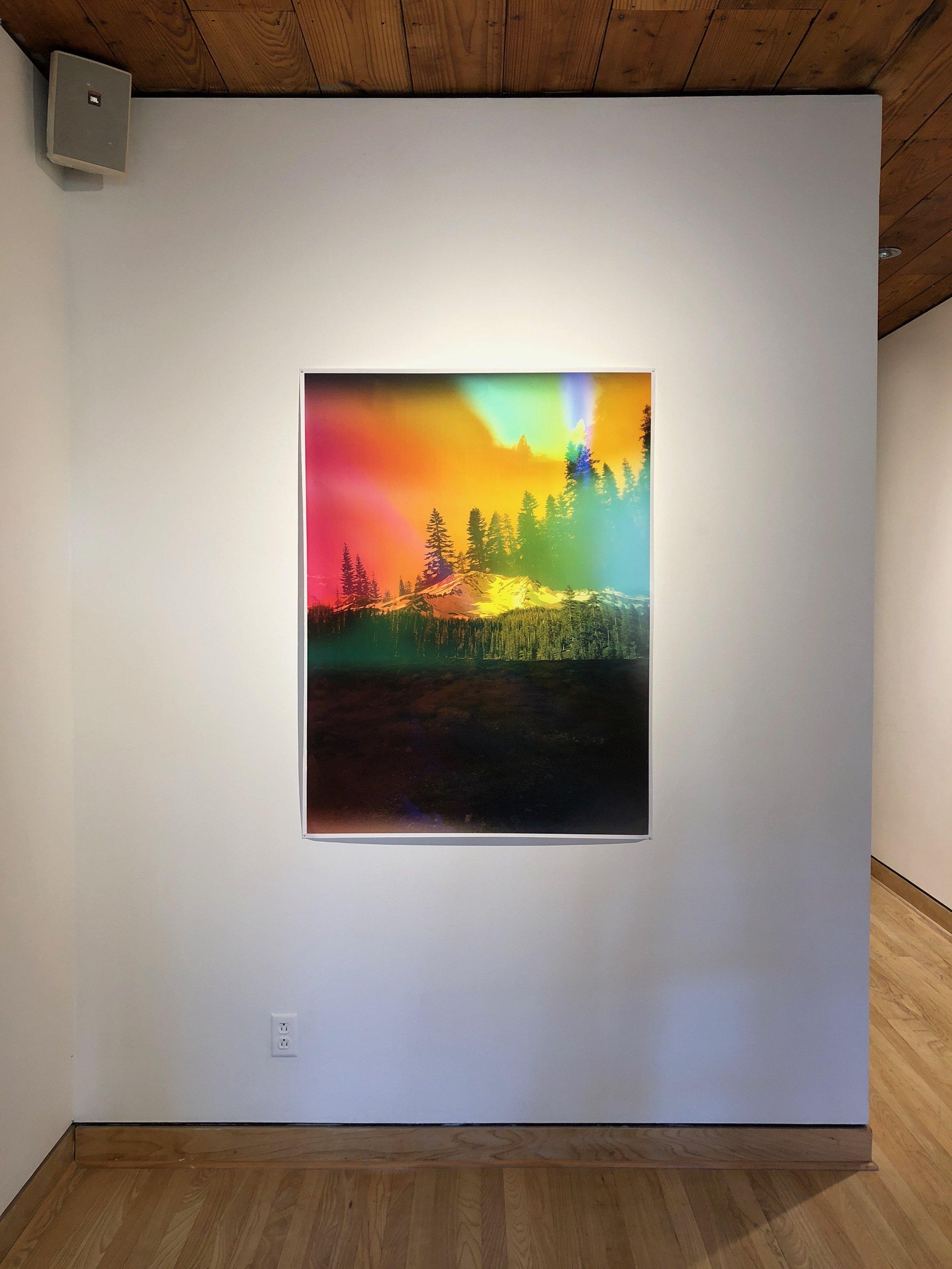 Installation view of Multiple Realities / Particular Truth, Flatland Gallery, Houston TX.  Mount Shasta Aura , Industrial inkjet print on newsprint, 48 x 36 in, 2017.