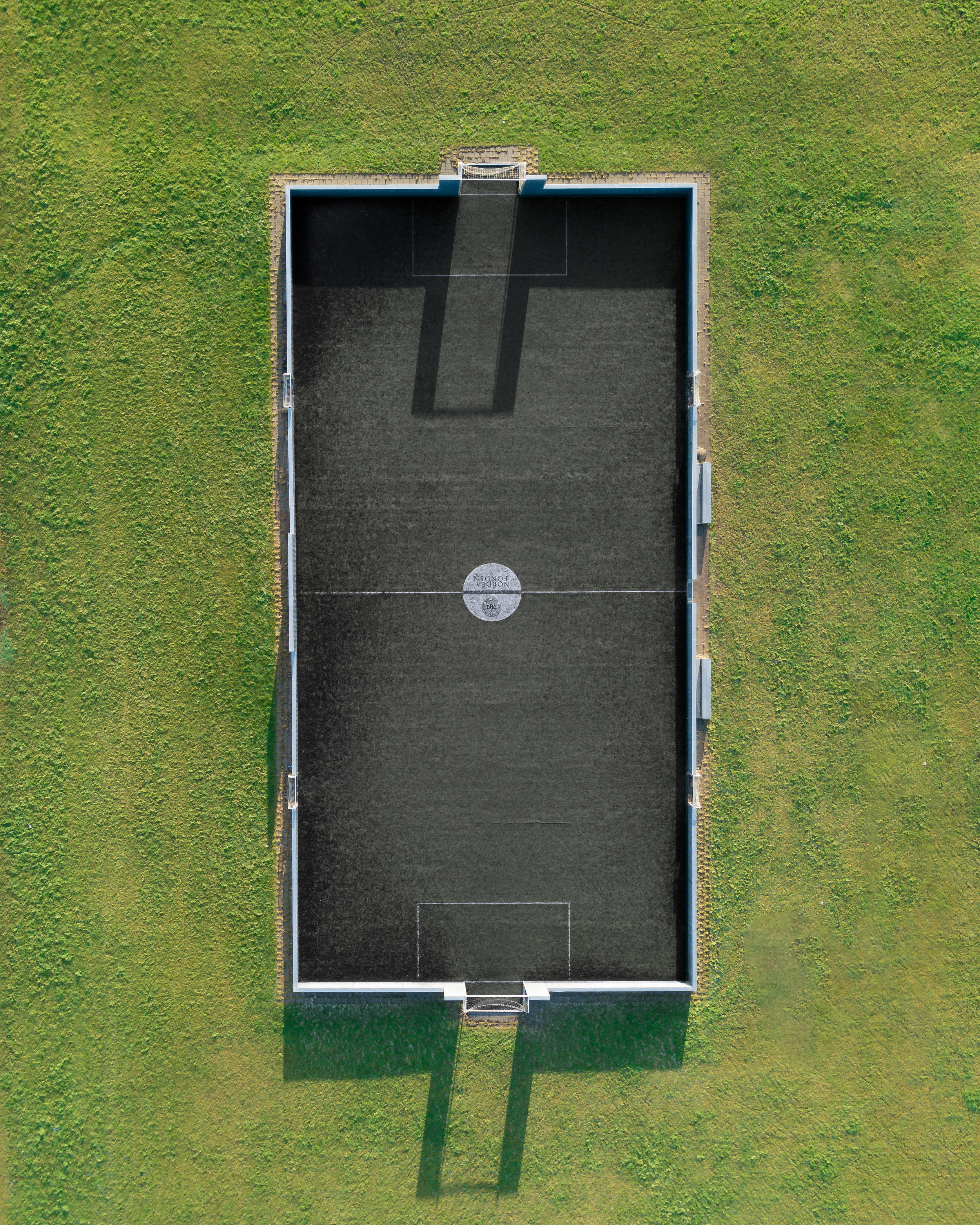 A local football field. I'm not too keen on football, so I've no idea why you wouldn't just play on the grass.