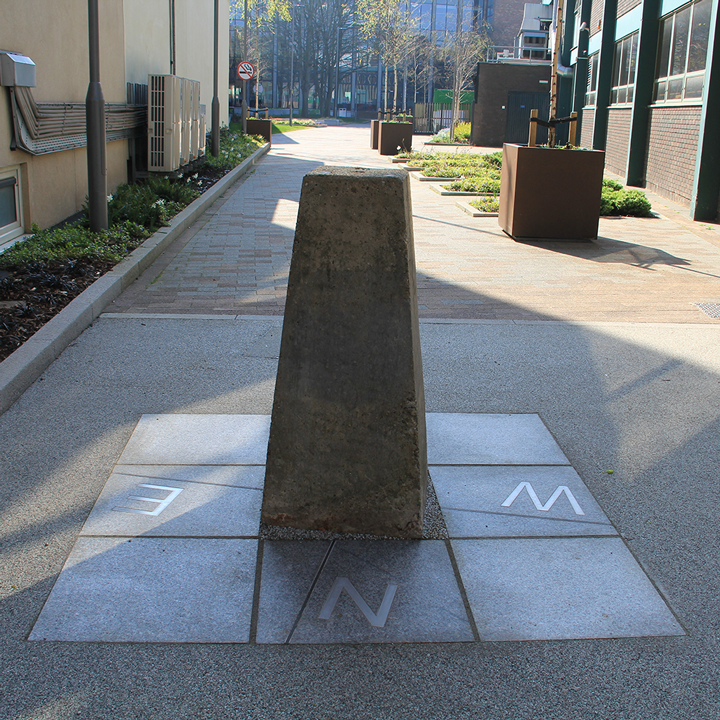 An existing concrete trig point was retained at this small student walkthrough space at Coventry University. LBD's design included added compass points to create focal/meeting point as part of wider refurbishment works to improve pedestrian flows.