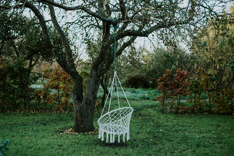 swing-hanging-from-old-apple-tree