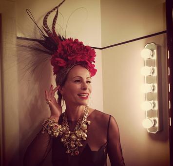 Andrea Dellal in her bespoke leopard print turban for Mario Testino's birthday celebrations.