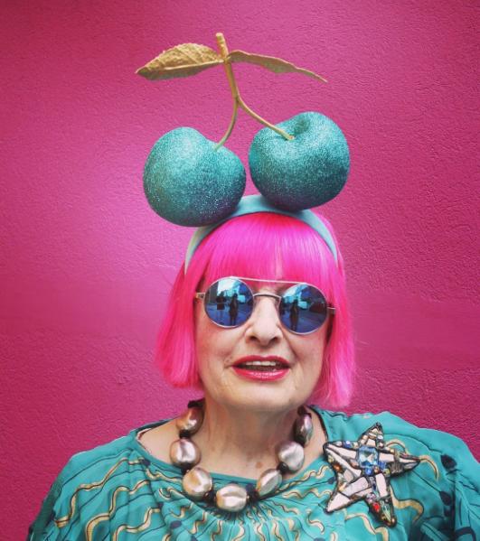 Zandra Rhodes wearing Bespoke Glitter Hyper-Cherries to Buckingham Palace