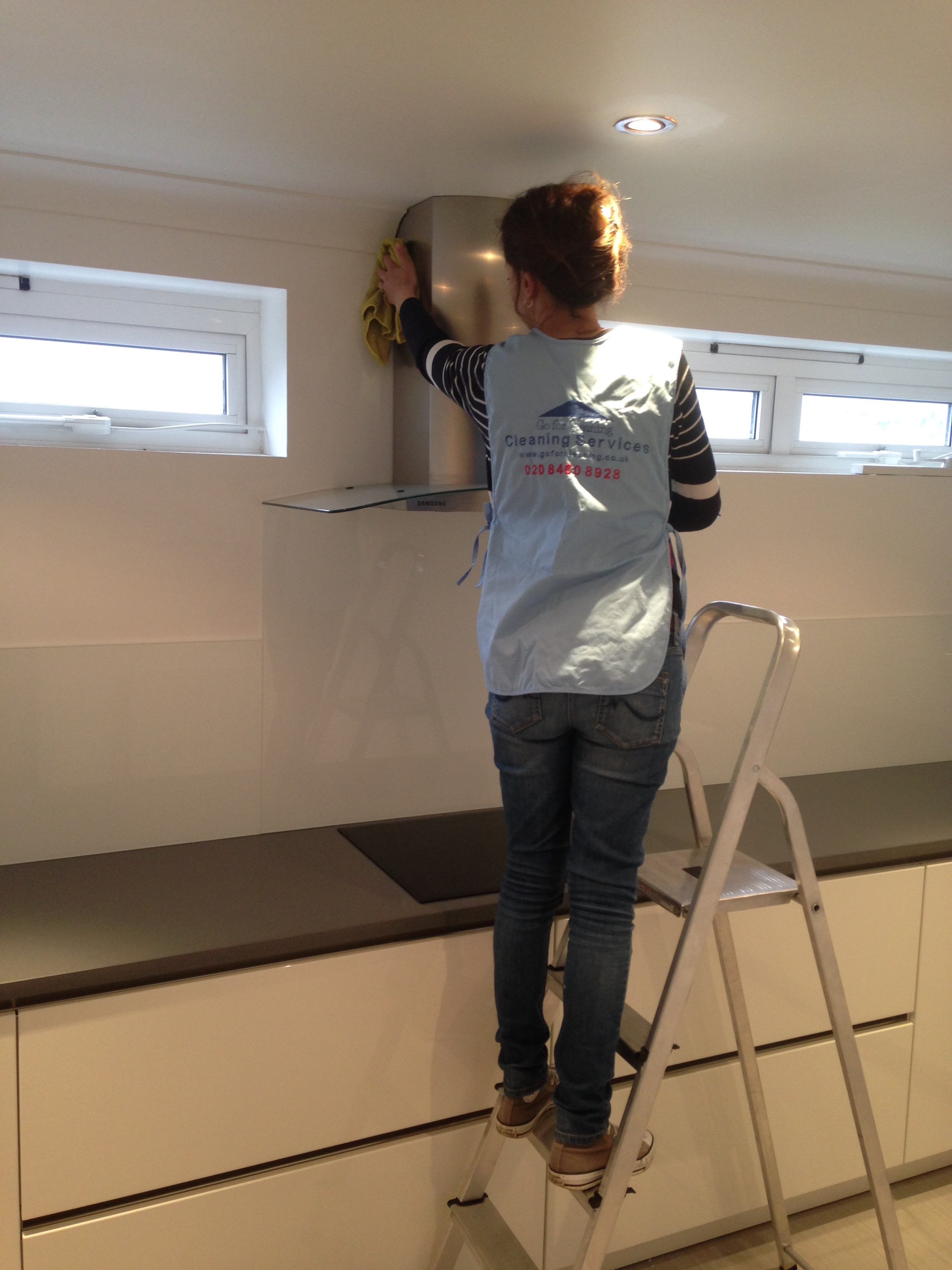 cleaning top of kitchen units in W6 area.jpg