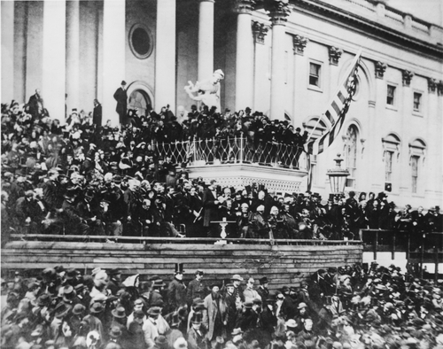Abraham Lincoln's delivering his second inaugural address (standing, center) on the east portico of the U.S. Capitol, March 4, 1865, his second inauguration. Image ID: 239400004 Copyright: Everett Historical.