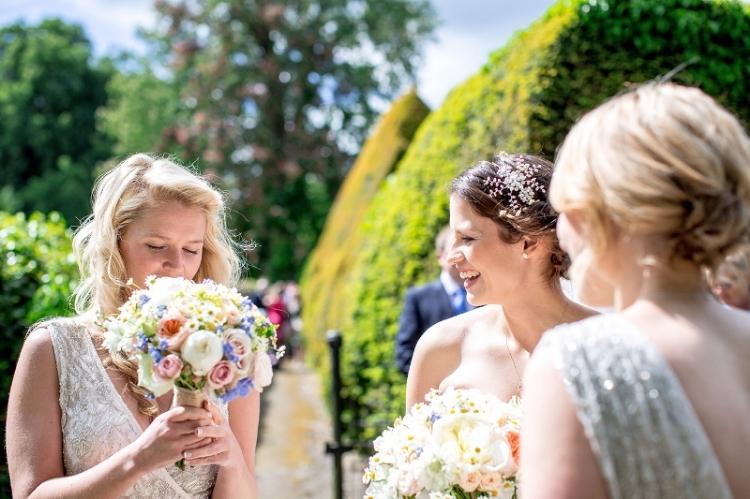 Summer wedding bouquet in pastel pink, peach, cream and blue