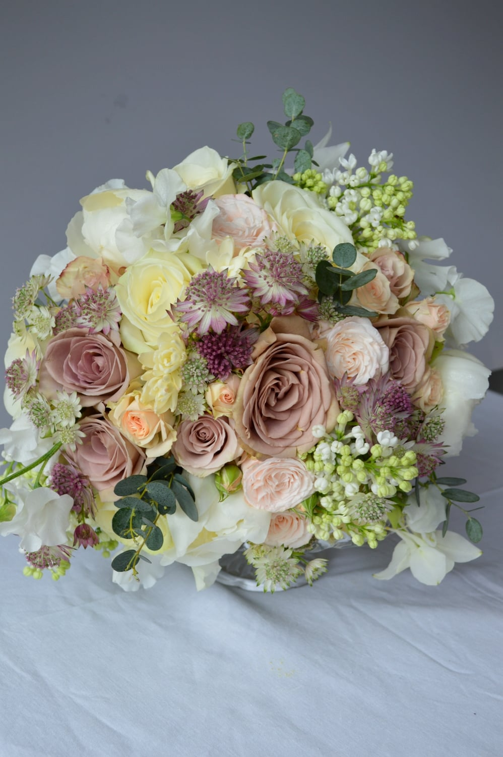 Spring bridesmaids bouquet in white & lilac with peonies, roses and sweet peas