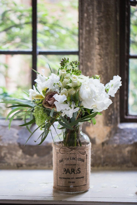 Rustic jar of wedding flowers