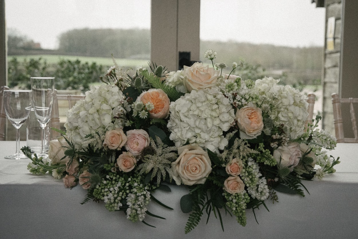 Soft peach, blush & white wedding top table flowers, Stratton Court Barn, Oxs