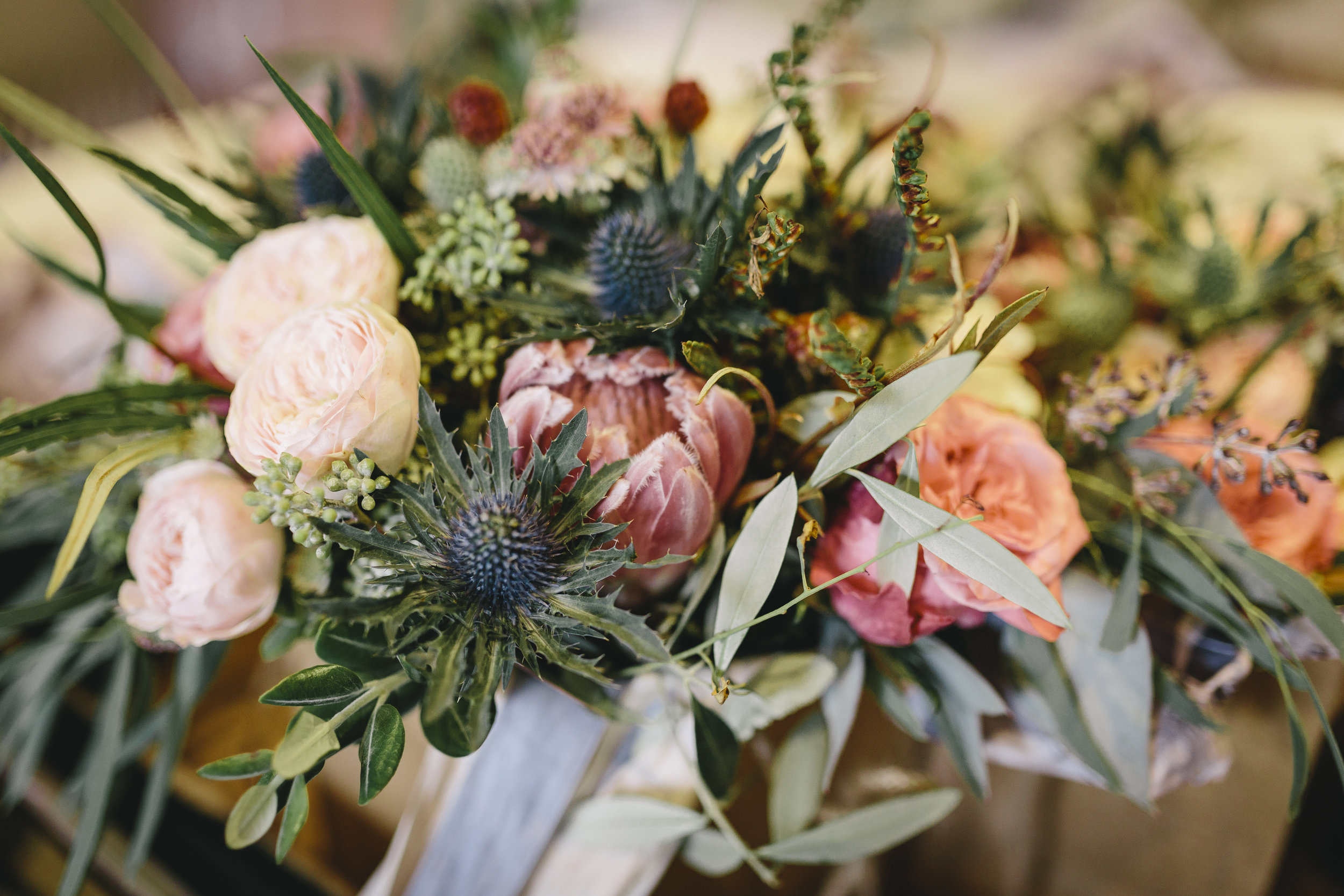 Bridal bouquet with protea, eryngium and roses
