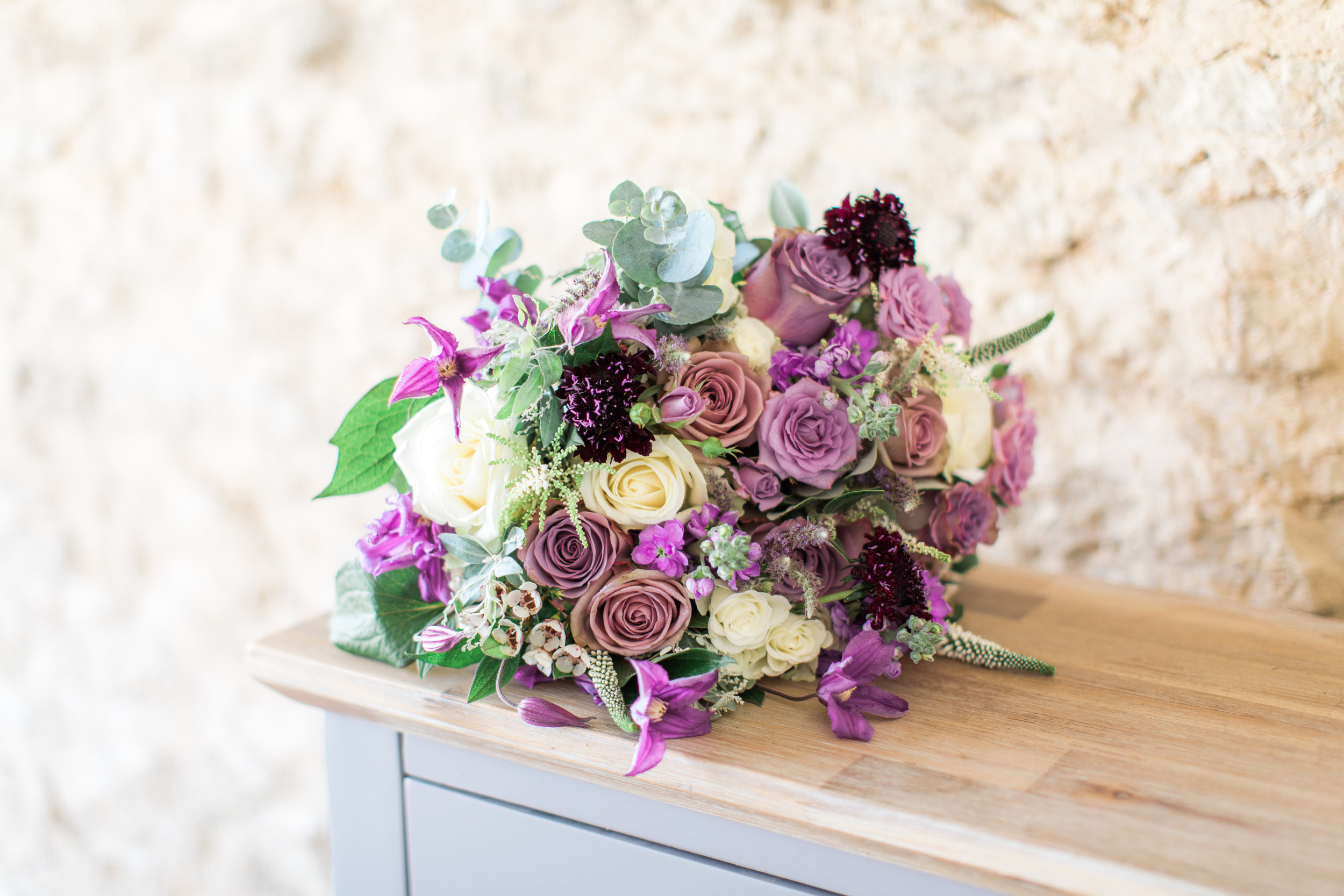 Lilac, cream and plum bridal bouquet at Stratton Court Barn, Oxfordshire