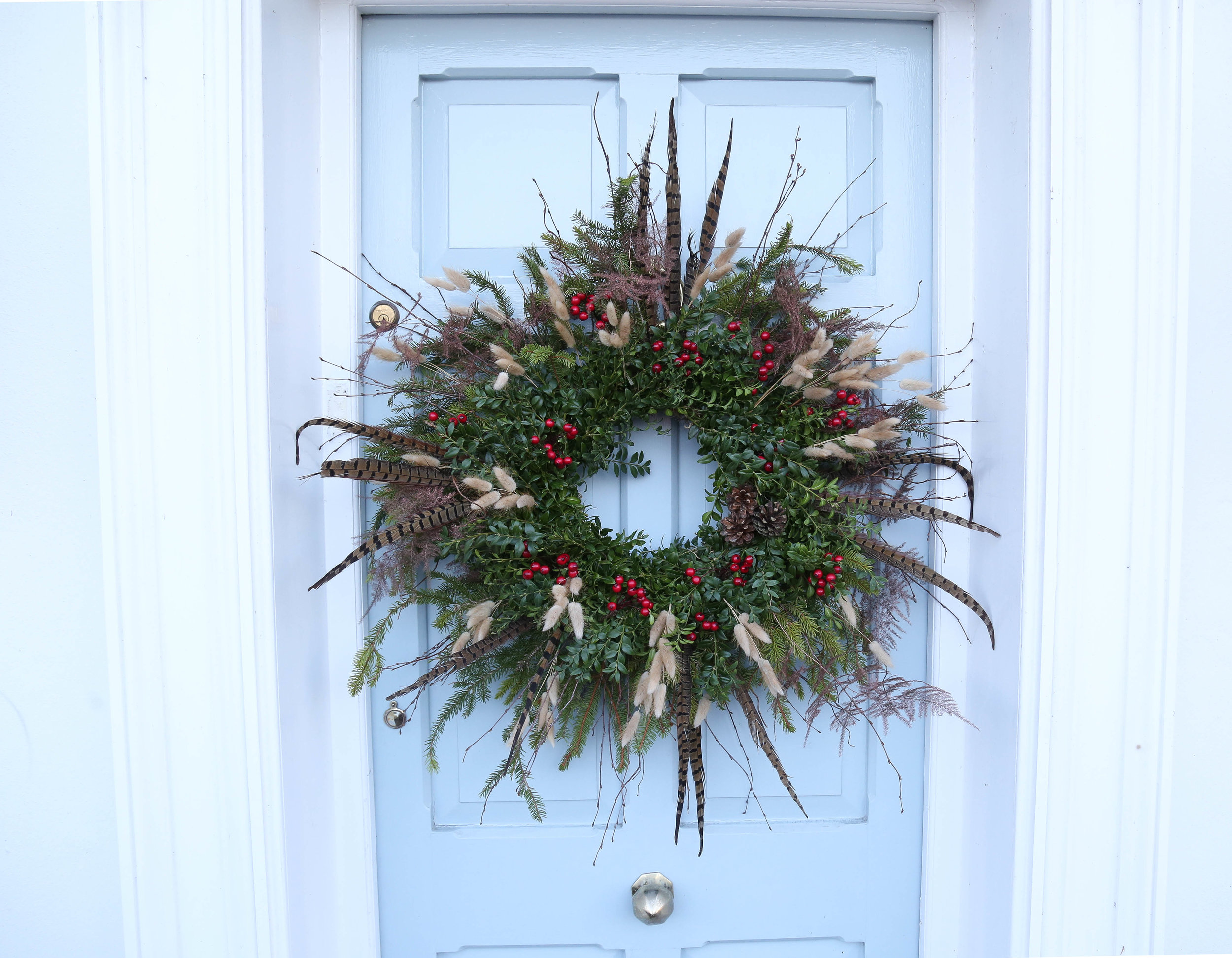 wild, rustic cChristmas wreath with pheasant feathers