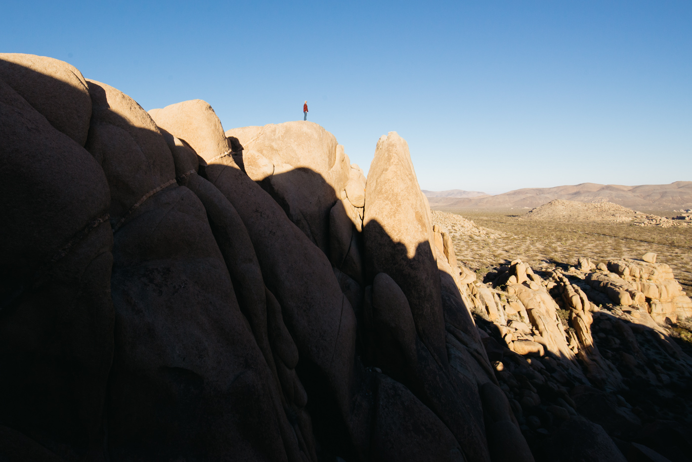 joshua tree man standing on cliff winter camp cold pawlowski