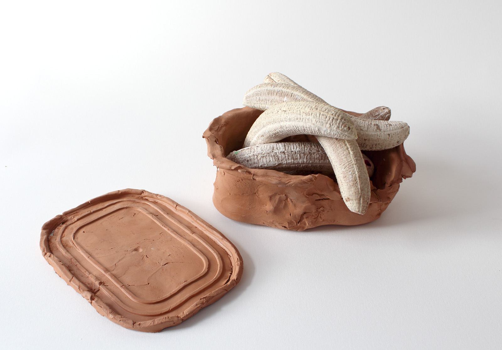 Untitled (Tupperware) , 2015  Plaster, air-dry clay  15 x 10 x 7 in