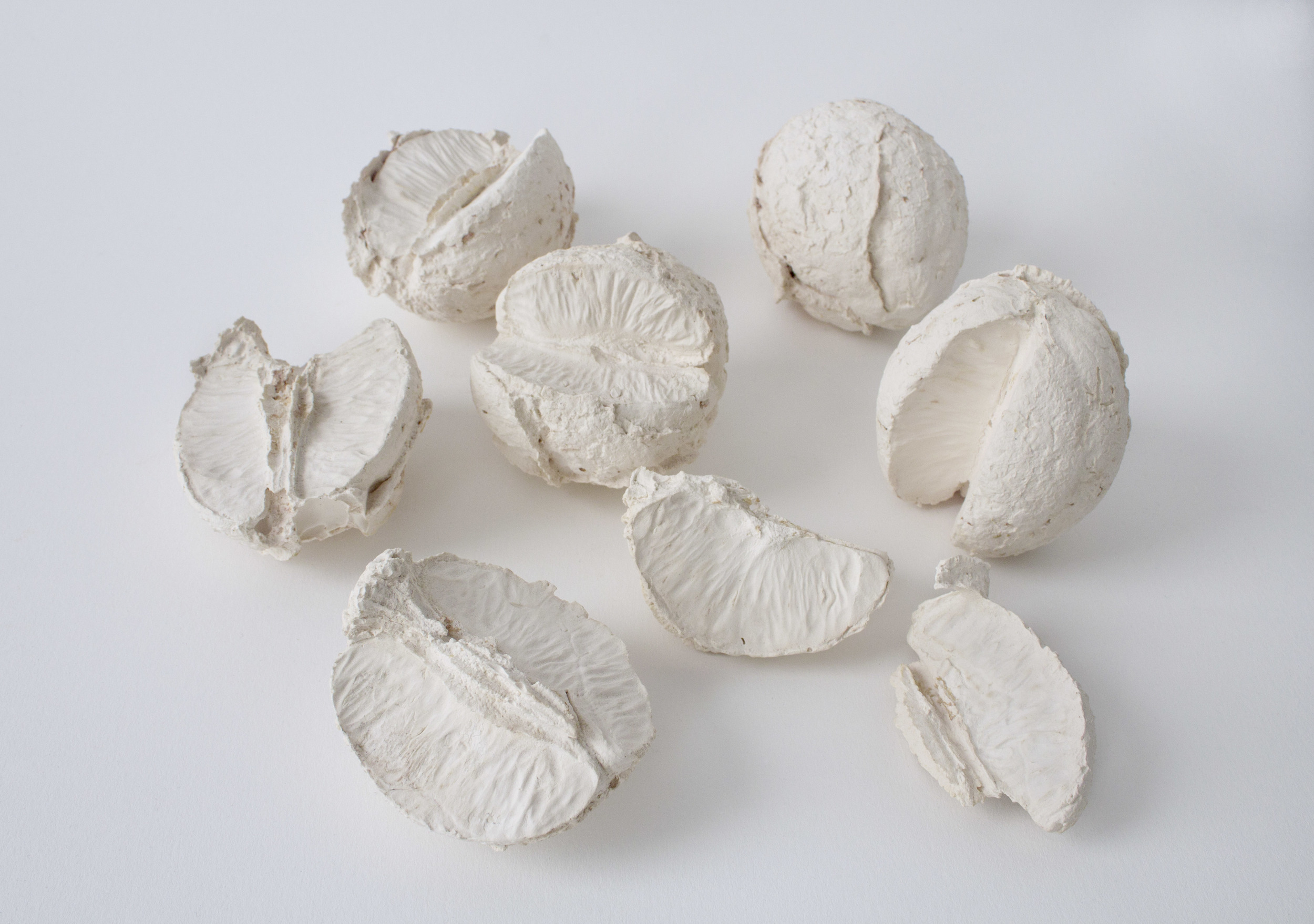 Untitled (oranges) , 2013  Plaster  7 x 8 x 3 in (group)