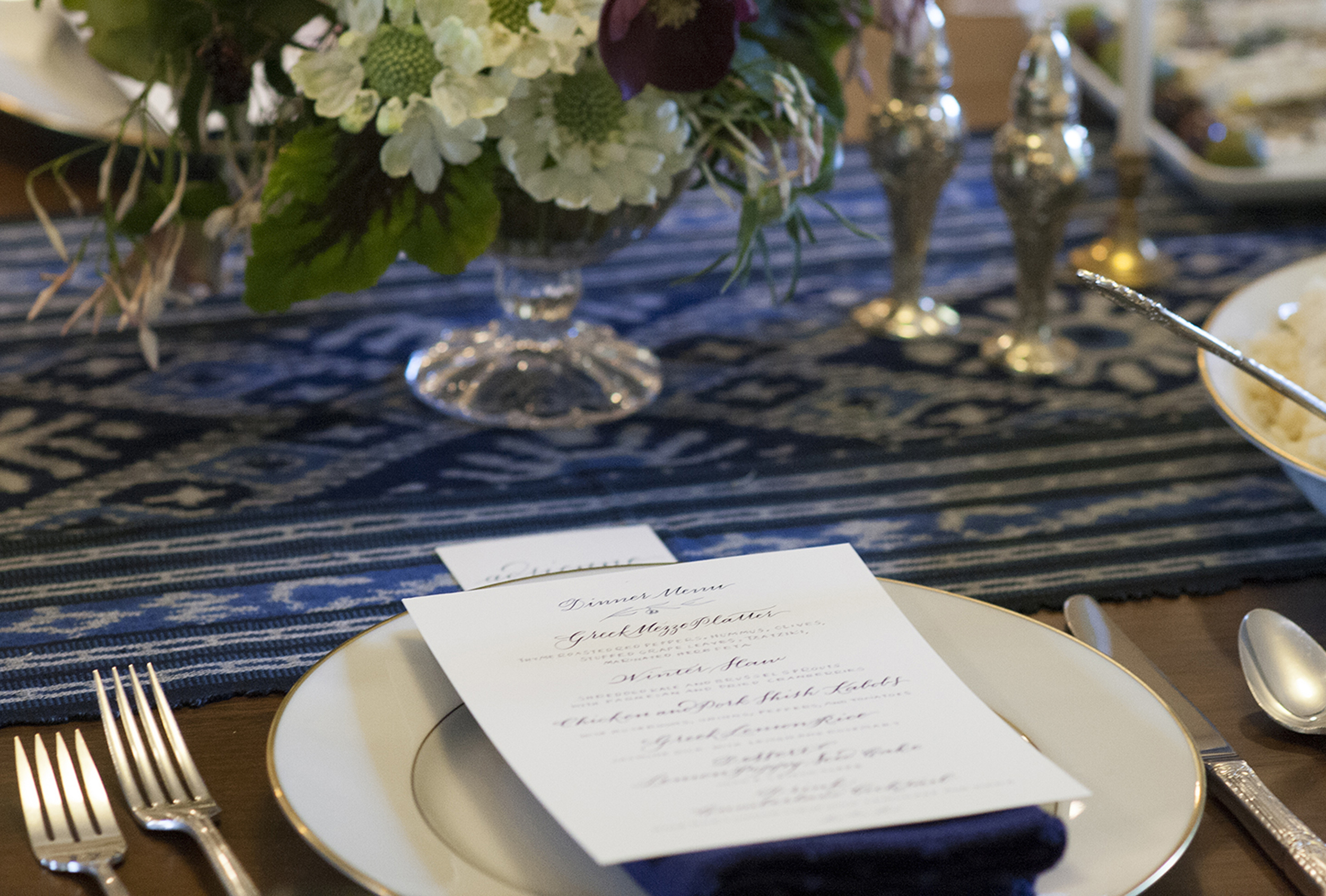 Place setting of the calligraphed menu at a client's dinner party. Floral arrangements done by  Wylde .