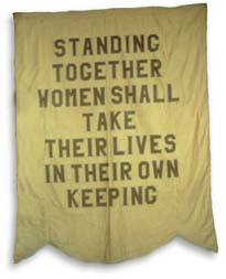 Gold banner with purple lettering produced by the National Woman's Party. The Party, in spite of its close ties to the British movement, adopted the traditional American color of gold.