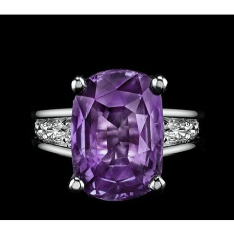 Beautiful rare velvety purple 8.00ct sapphire in a platinum setting with diamond accents by  Robert Procop.