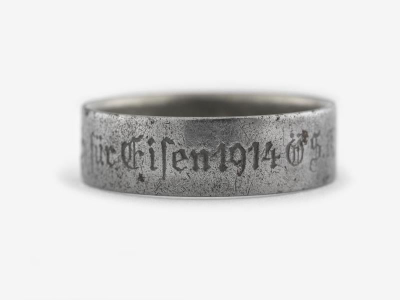 Engraved iron finger ring given as replacement for gold jewelry offered as gift to the war funds of the Austro-Hungarian empire during the First World War.  inscribed 'Gold gab ich fur Eisen 1914' Coutesy of the Imperial War Museums © Crown Copyright: IWM