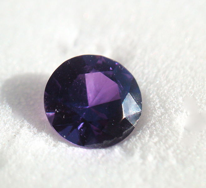 0.37 carat, purple Yogo sapphire from Yogo Gulch, Montana.  PHOTO BY PUMPKINSKY