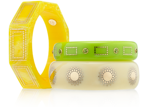 BANGLES CREATED FROM VINTAGE BAKELITE WITH 18 KARAT GOLD WIRE INLAY AND PERIDOT.