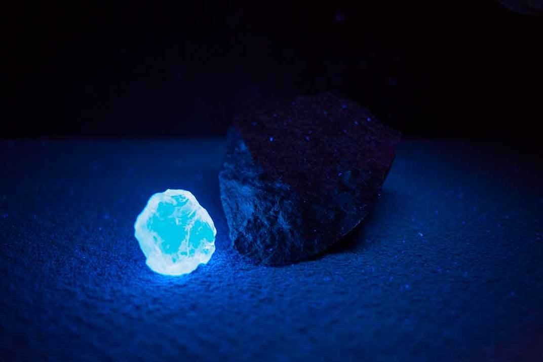 Trace amounts of nitrogen cause the DIAMOND to glow bright blue under a black light.  (Photo by Donny Bajohr)
