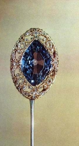 Russian stickpin with a 7.50 carat blue diamond rumored to have been cut from the same blue diamond as the Hope Diamond.