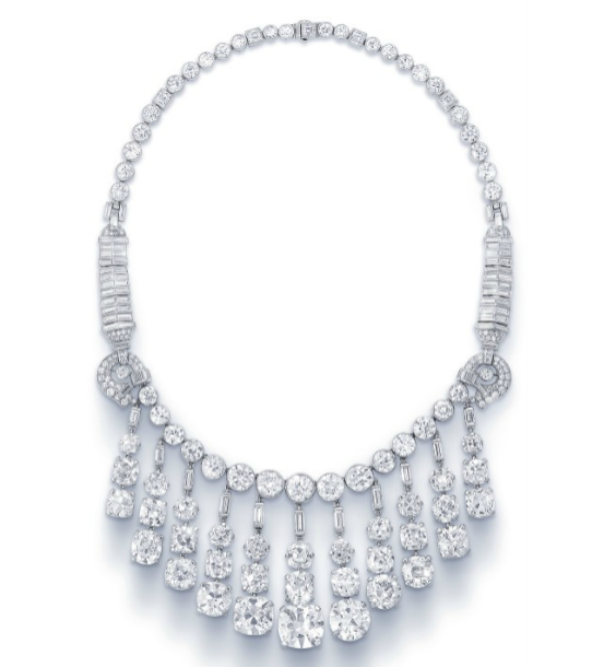 A superb diamond fringe necklace with square, old and baguette-cut diamonds as well as cushion, and single old-cut diamonds set in platinum.Signed Cartier