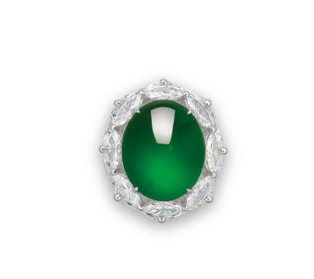 A natural jadeite and diamond ring. A natural oval jadeite cabochon, within a marquise-cut diamond two-tiered surround, to the circular-cut diamond three quarter-hoop, mounted in gold