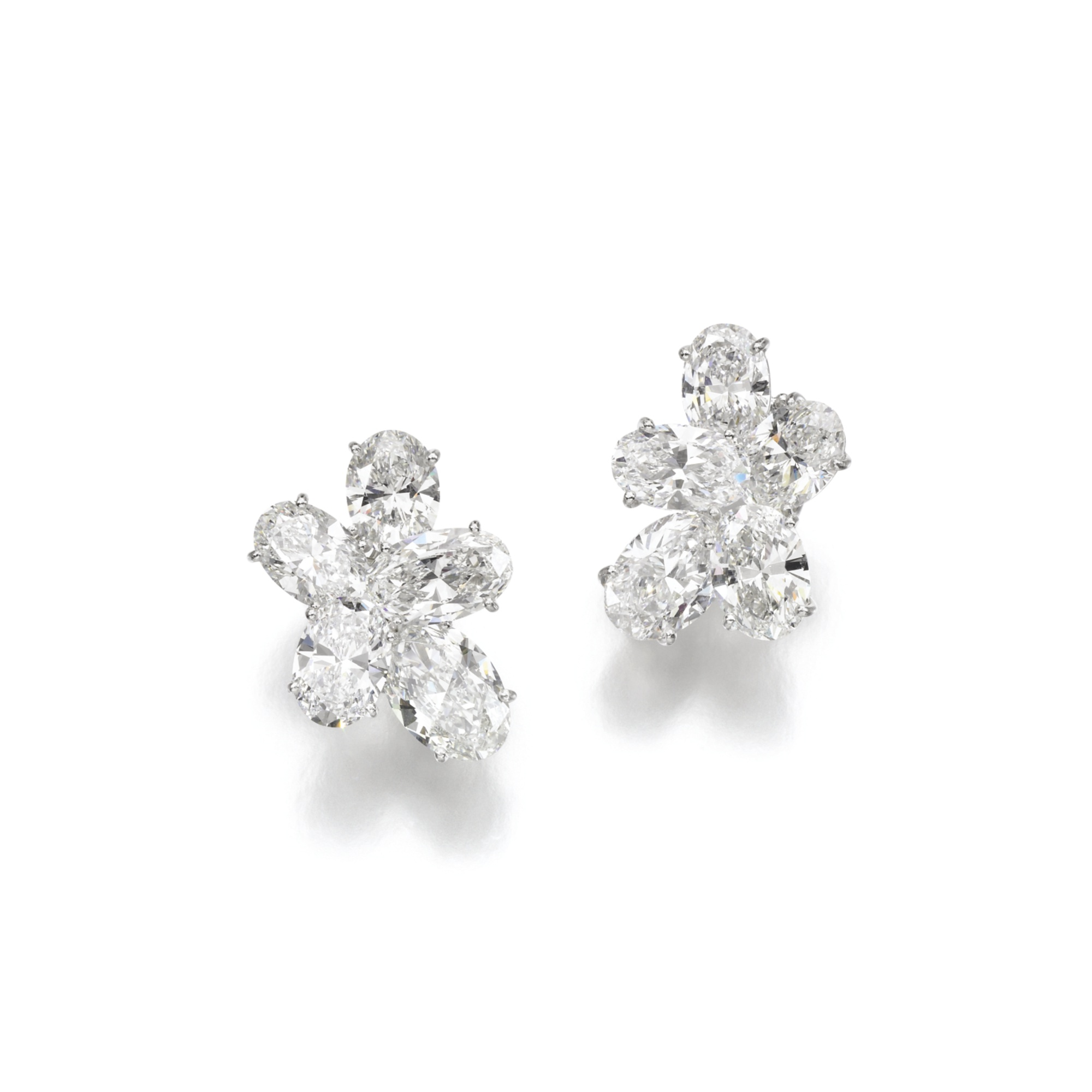 Pair of attractive diamond ear clips. Diamonds range from 2.01 to 3.08 carats.Accompanied by ten photocopies of GIA reports, stating that the diamonds ranging from 2.01 to 3.08 carats, are D to F Colour, Internally Flawless to VS2 Clarity.