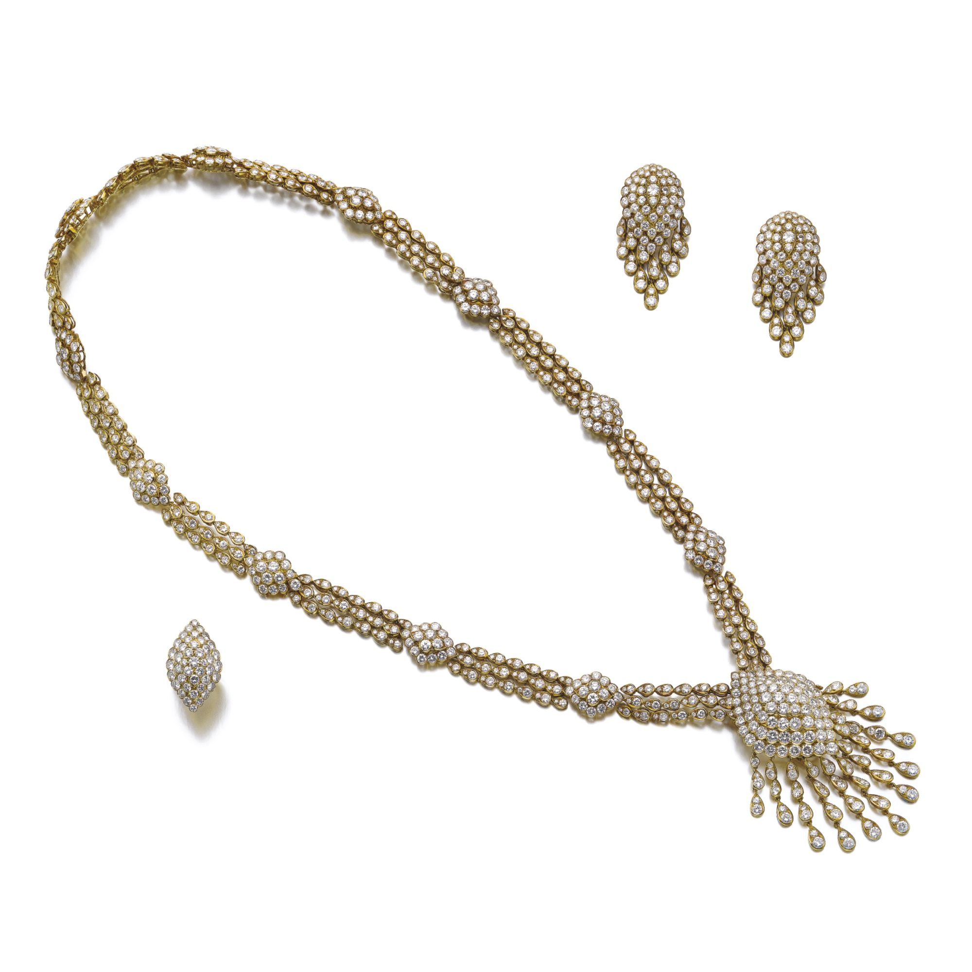 Diamond parure, Van Cleef & Arpels. Comprised of: a sautoir set with brilliant-cut diamonds, supporting a detachable pendant that can be worn as a brooch, a pair of ear clips and a ring