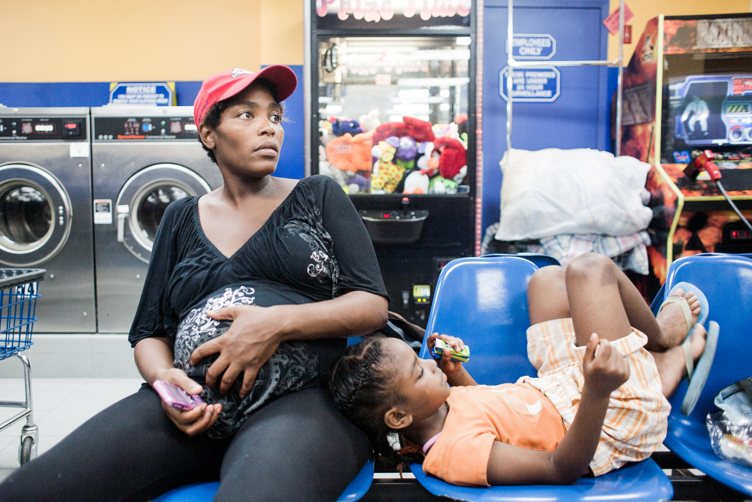 Roberta at the laundromat with Siera, 2010.