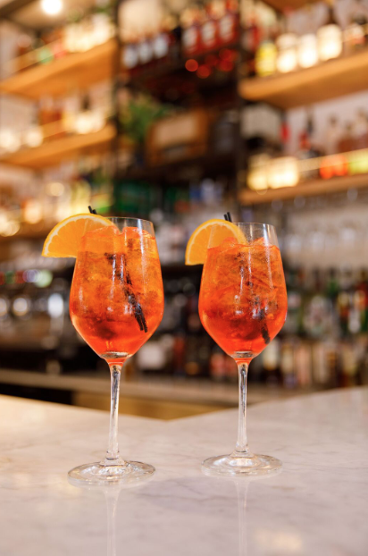 Two Aperol Spritz on Tarallucci e Vino - East Village bar counter.
