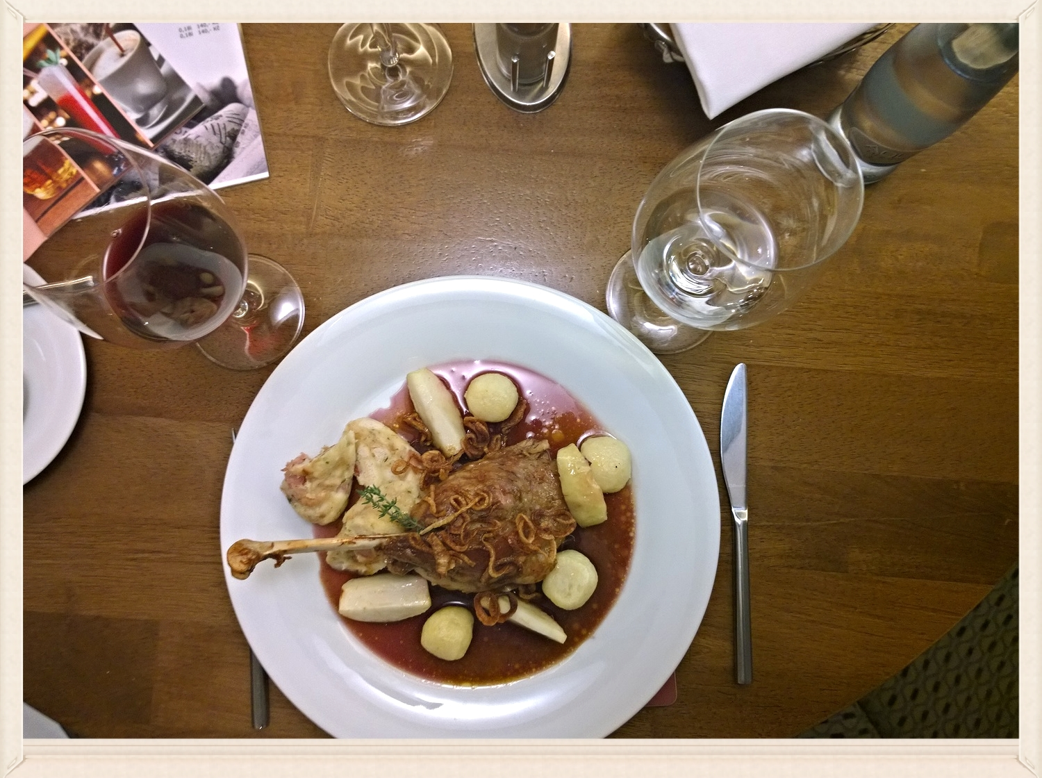 Roasted goose leg with apples, potato dumplings and red sauerkraut pared with a local Czech red wine.