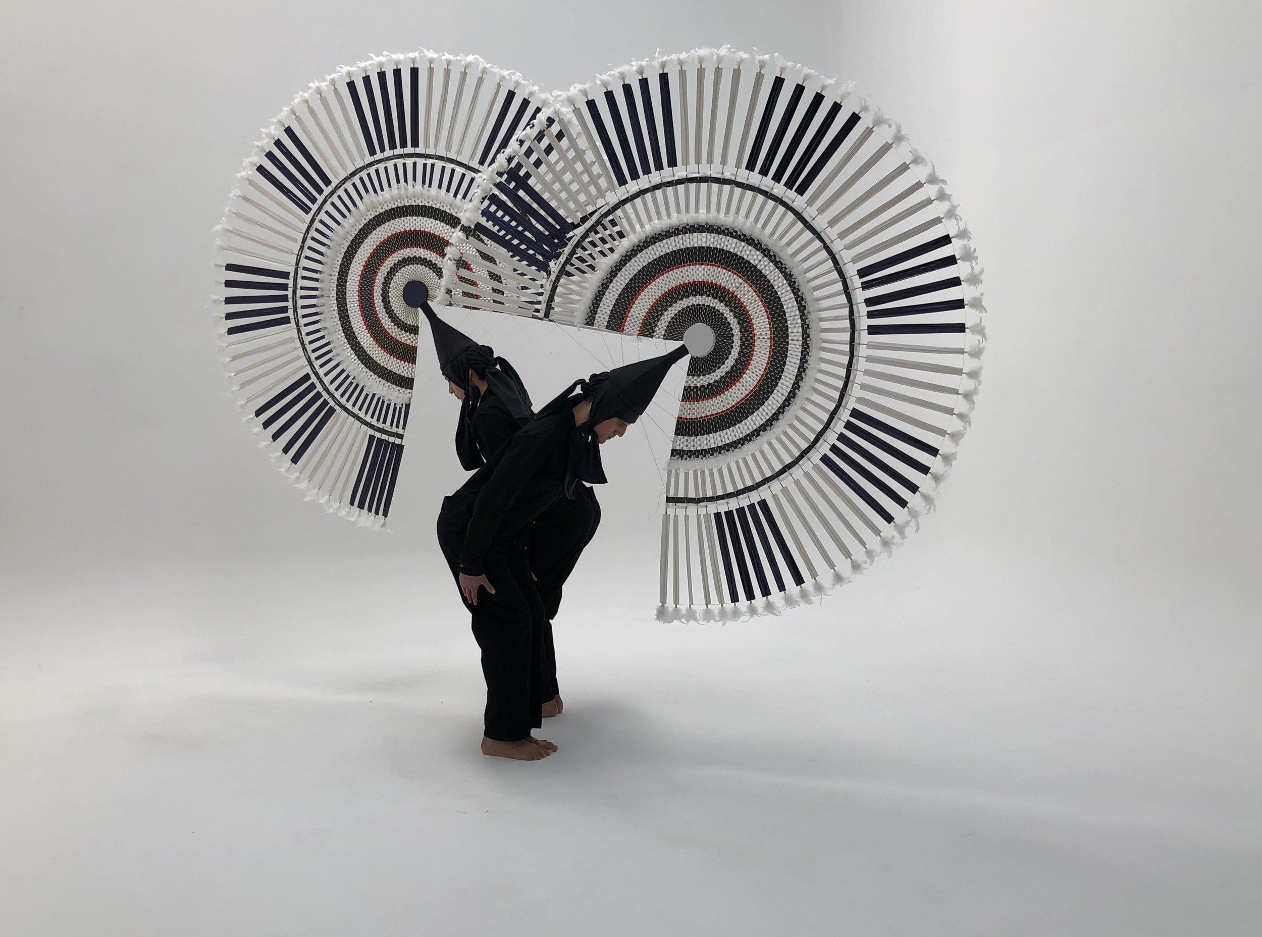 Image Credit: Tania Candiani, Reverencia , 2019, Choreographic Action Penachos: Maestro Marcos Anderete Dancers,Francisco Rojas and Carlos Coronel. Courtesy of the artist and Galeria Vermelho.