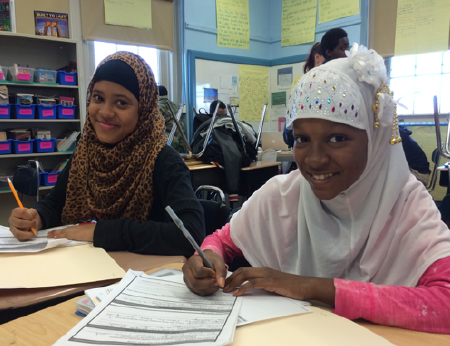 Middle school students prepare for student-led conferences during an advisory session.