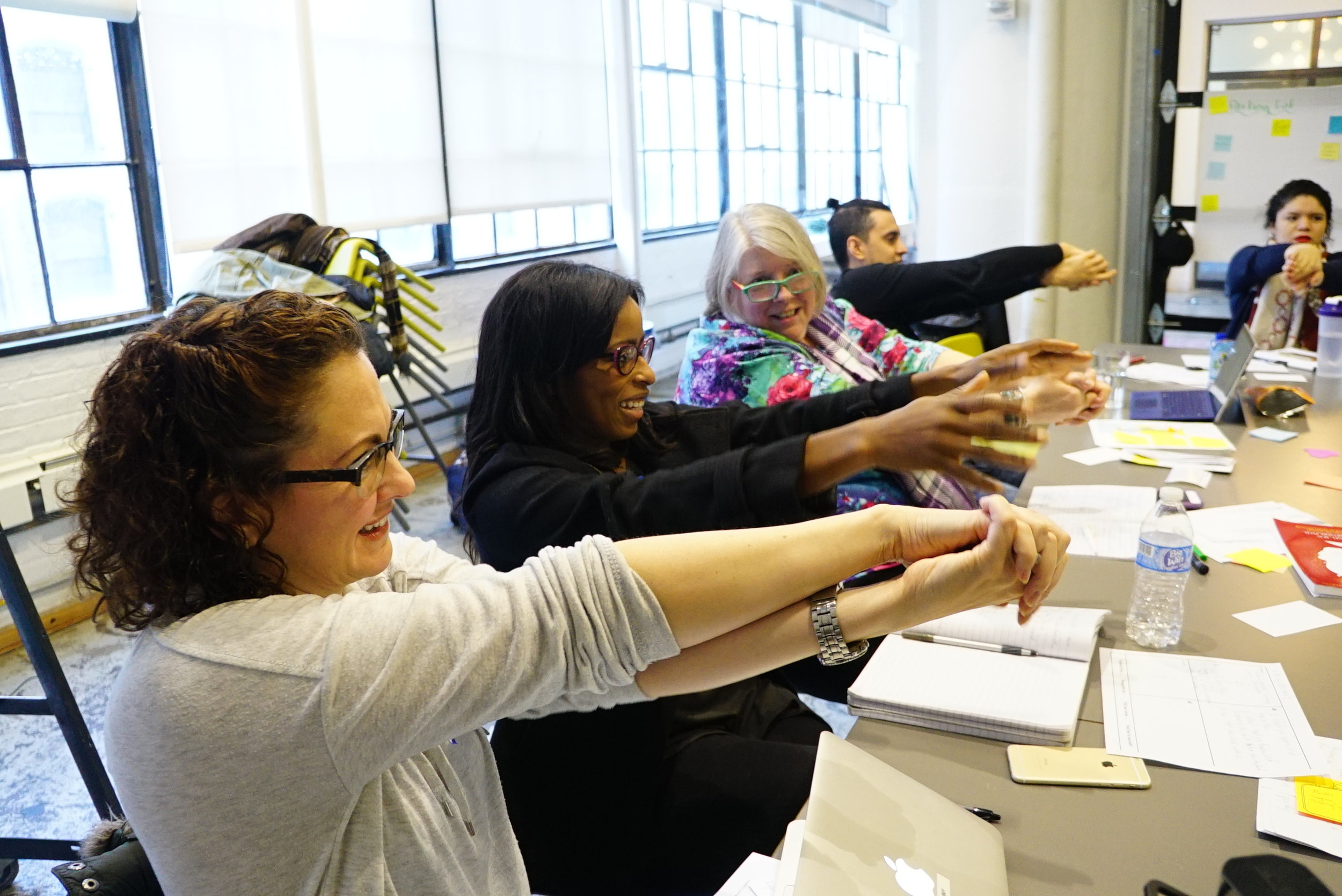 Participants smile as they repeatedly fail at this activity!