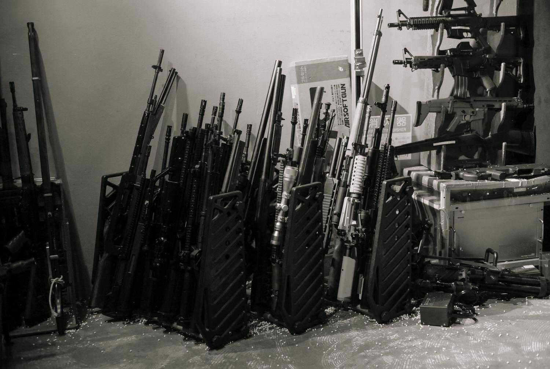 The vast arsenal of guns at the bar.