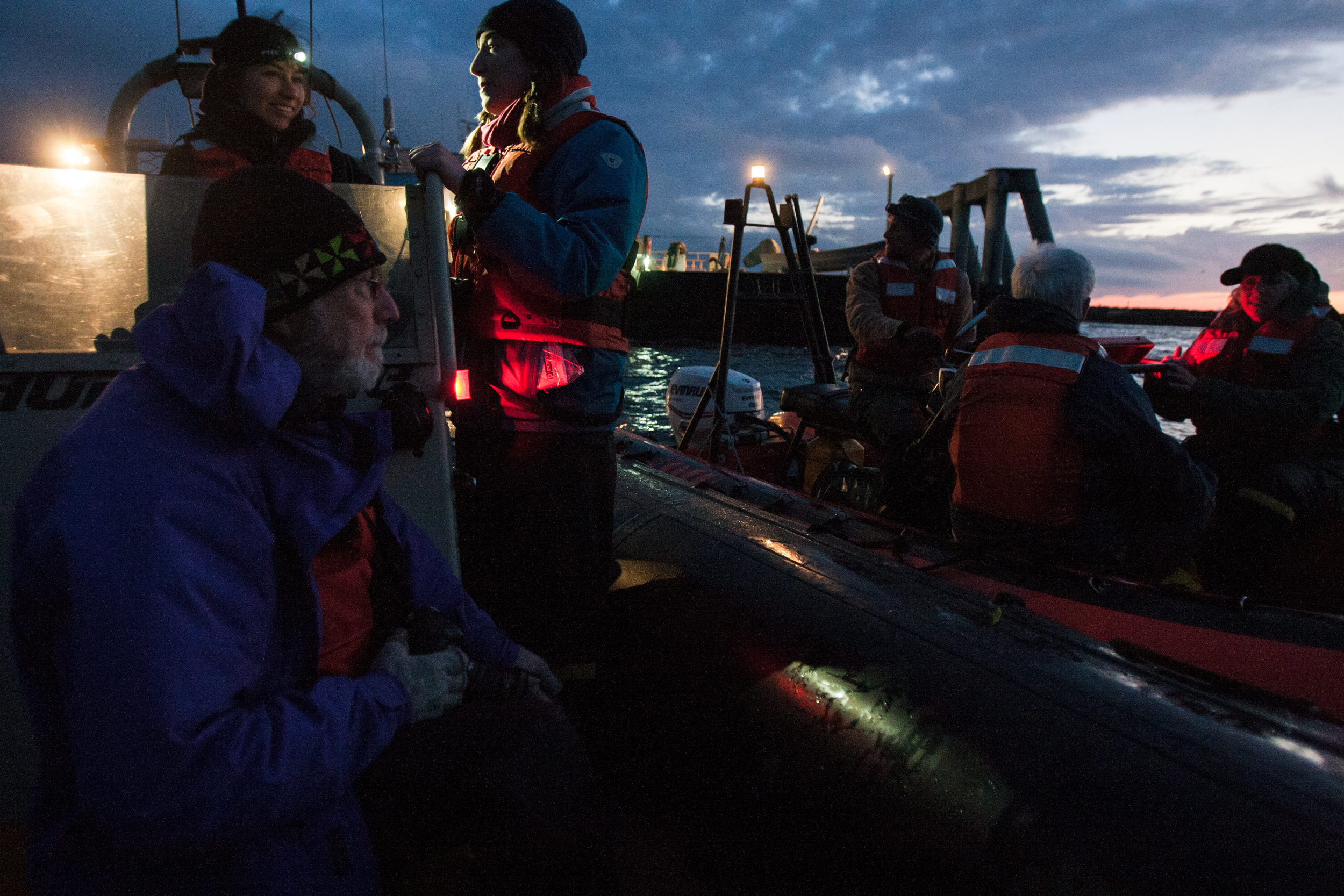 In the early morning light, Greenpeace activists and members of the media prepare to meet the Polar Pioneer as it arrived in Port Angeles, Washington on April 17, 2015.