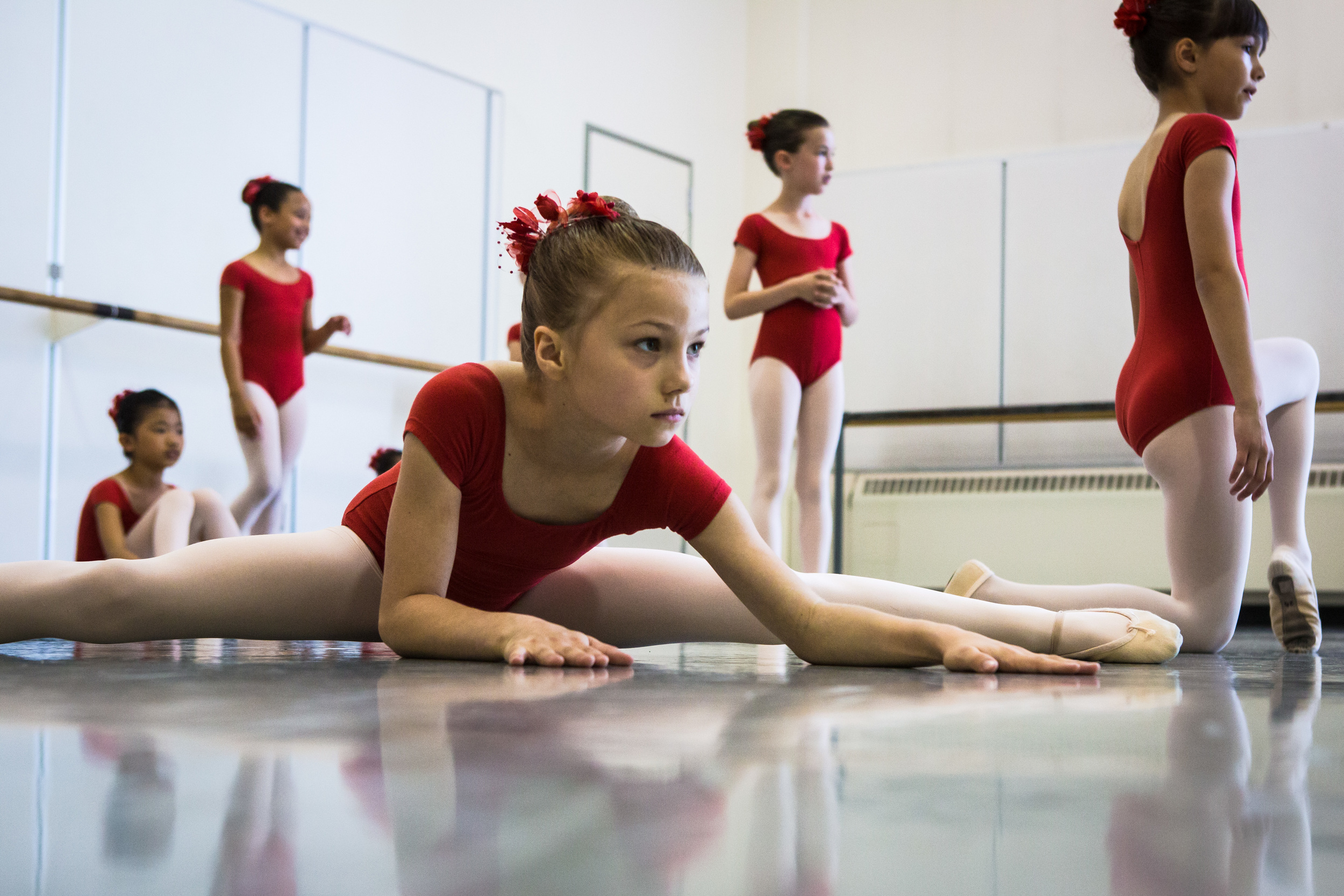 Students stretch before performing in Pacific Northwest Ballet's 21st annual DanceChance Observation Day on Saturday, June 6, 2015. The program offers full scholarships for students to train twice a week with the PNB School. The performance showcased the dancers' hard work for friends, family and supporters of the program.