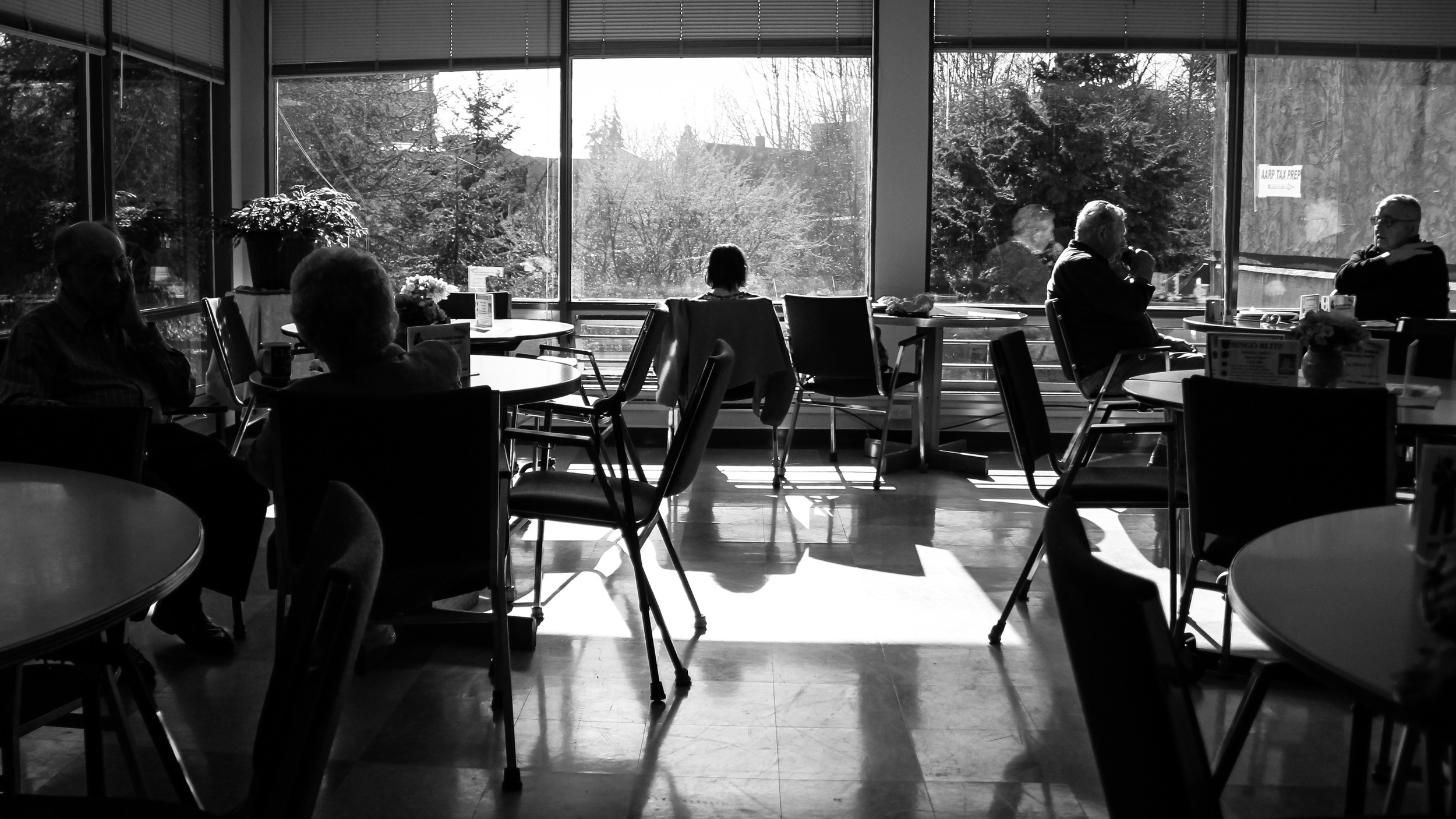 Members of the Bellingham Senior Activity Center enjoy a sunny afternoon in March after a long few months of rain. Bob Souders and his wife, left, sit and chat after playing a few rounds of pool. The center is open Monday through Saturday and offers a wide spectrum of classes and activities for senior members. Many come regularly for classes and many just for the company of others.
