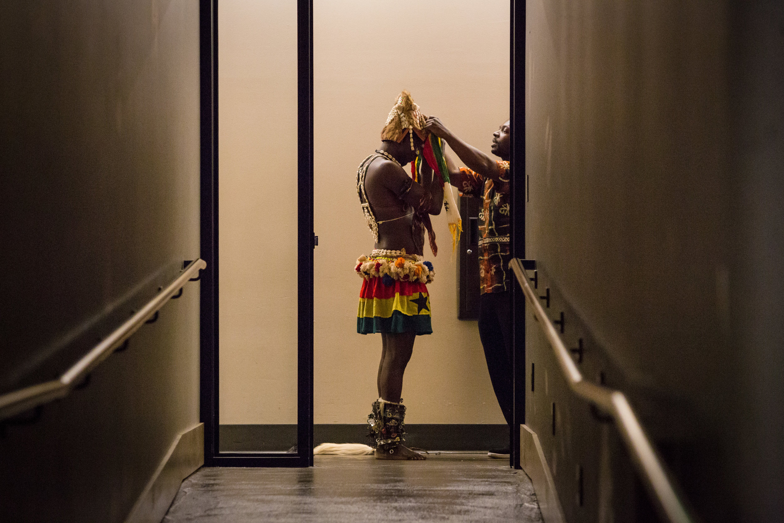 Members of Anokye Agofomma, a group that performs traditional music and dance from Ghana, get ready for their performance during Hugs for Ghana's annual Culture Night fundraiser on Friday, Mar. 18, 2016 in Mukilteo, Wa. Attendees gathered at the Rosehill Community Center to raise money for supplies for schools in Ghana.
