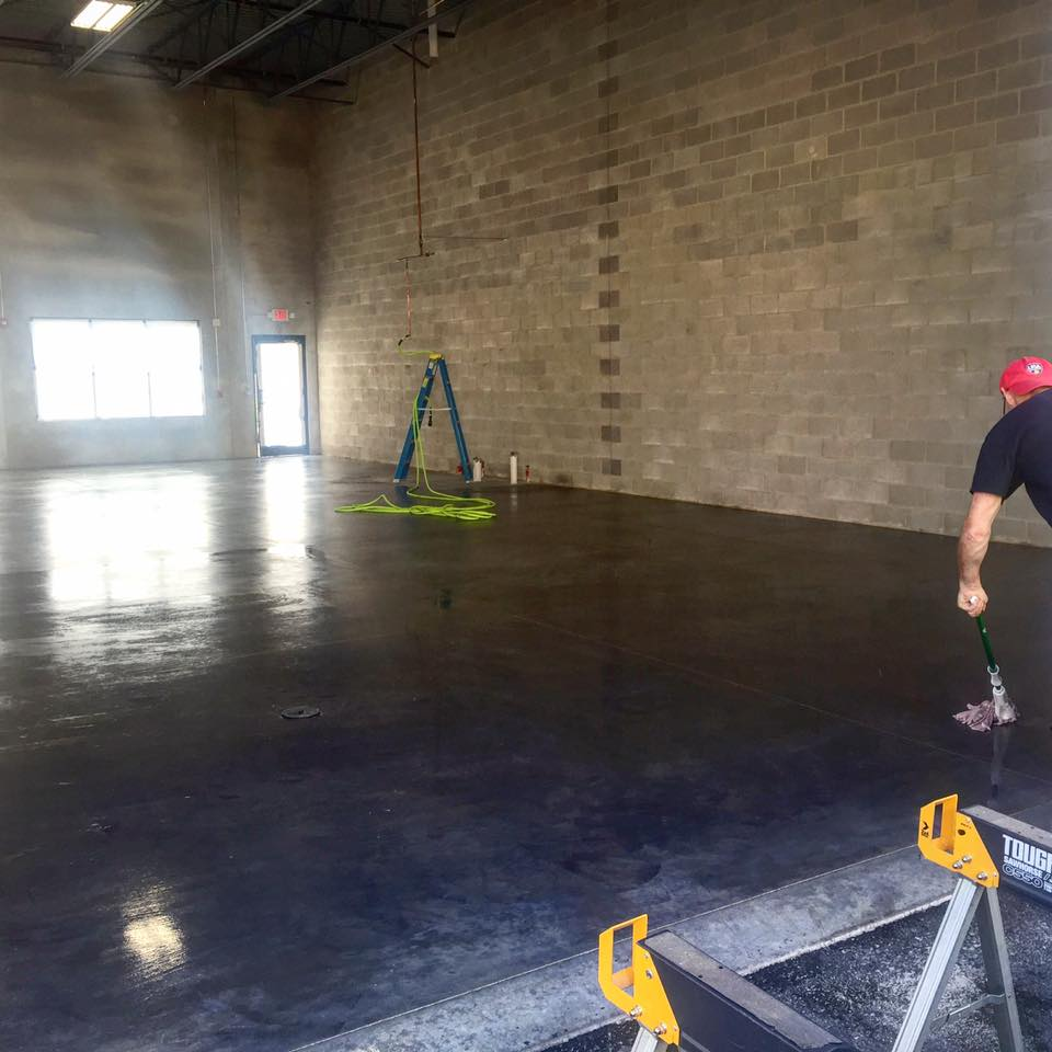 Prepping and sealing the new concrete floor.