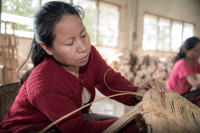 Seng Urdakham, 40, weaves rattan chairs and products at the Danlao Factory in Vientiane, Laos. Photo by ©Thippakone Thammavongsa / WWF-Laos via  wwf.exposure.co