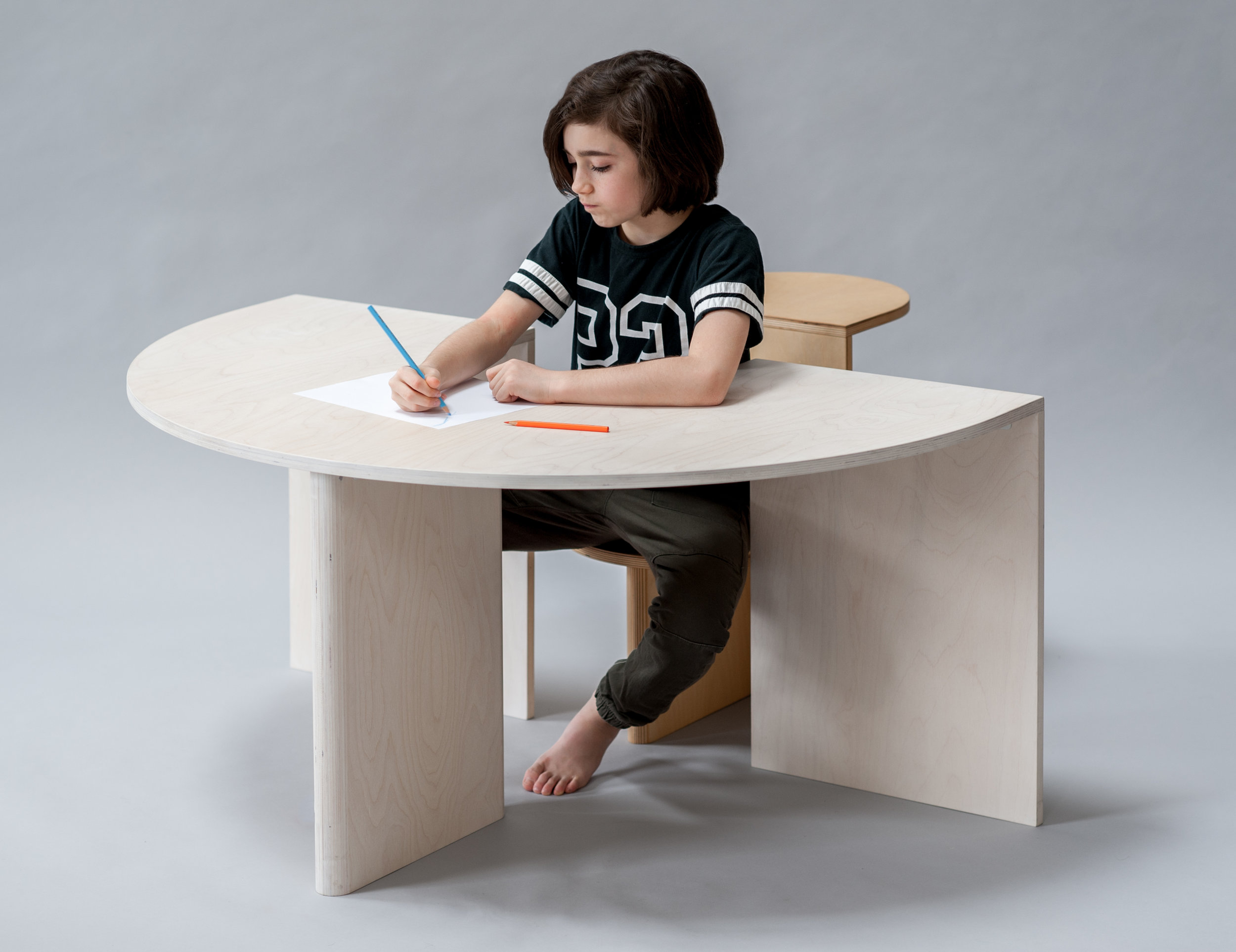 Lunar Table and Eclipse Chair by studiokinder. Photo via  kindermodern.com