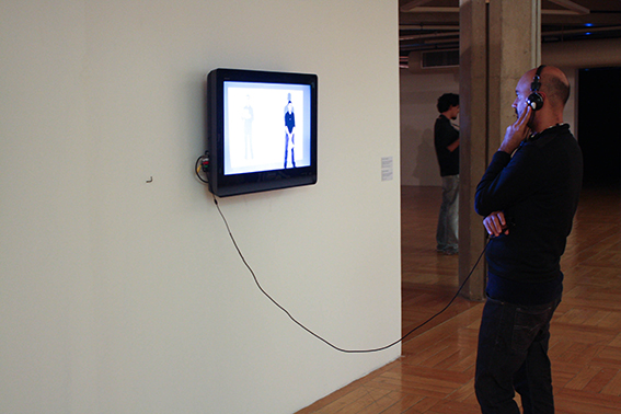 DECLARATION OF LOVE TO KOSUTH    SPECTATOR WATCHING THE VIDEO
