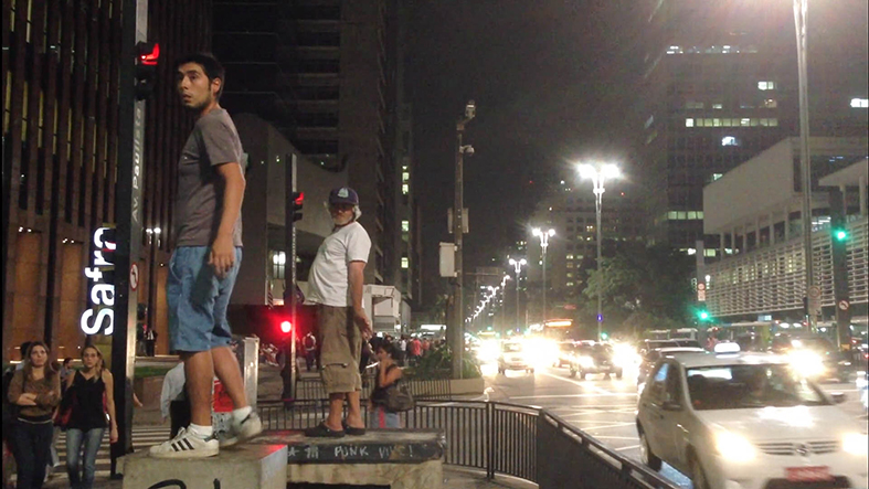 STARS ARE DANGEROUS... ALWAYS DANGEROUS    Video 4 min 48 sec     2013    Filmed at Avenida Paulista in Sao Paulo, the video   begins showing the performative action of a recog- nized street occupant who regularly placed himself on a platform and dance by himself apparently lis- tening to and old Walkman to which only he has access. After a few minutes of video pass the art- ist enters the frame standing on a platform that is exactly behind the occupant and begins to imitate the gestures and dance the renowned inhabitant is performing.     When the movements of the occupant and the artist come to be close and coordinated the video speed   is modified to slow motion for the time that such   link between the bodies are maintain. Once the in- habitant realizes that he had been being imitated he expulses the artist aggressively, sentencing: the stars are dangerous ... always dangerous.